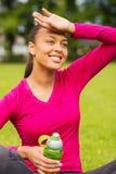 Smiling teenage girl showing bottle Stock Photography