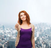 Smiling teenage girl showing thumbs up Royalty Free Stock Images