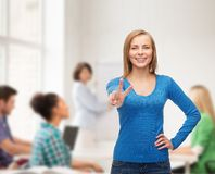 Smiling teenage girl showing v-sign with hand Stock Photos
