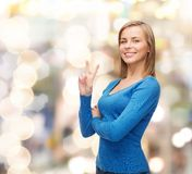 Smiling teenage girl showing v-sign with hand Stock Image