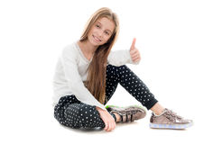 Smiling teenage girl sitting on the floor Royalty Free Stock Photo