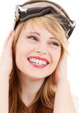 Smiling teenage girl in snowboard goggles Royalty Free Stock Images