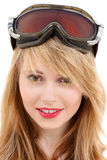 Smiling teenage girl in snowboard goggles Royalty Free Stock Image