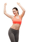 Smiling teenage girl in sportswear dancing Royalty Free Stock Photos