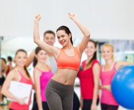 Smiling teenage girl in sportswear dancing Stock Image