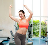 Smiling teenage girl in sportswear dancing Stock Photos
