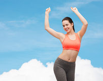 Smiling teenage girl in sportswear dancing Stock Photography