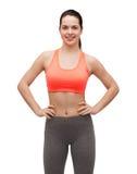 Smiling teenage girl in sportswear Stock Images