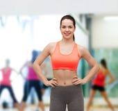 Smiling teenage girl in sportswear Stock Photo
