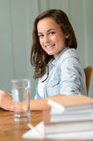 Smiling teenage girl student at home Stock Photo