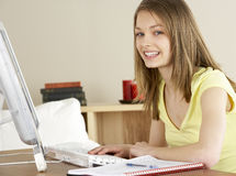 Smiling Teenage Girl Studying at Home Royalty Free Stock Images