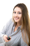 Smiling teenage girl switching channels on tv stock images