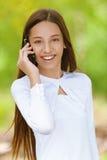 Smiling teenage girl talking on Stock Photos