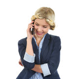 Smiling teenage girl talking mobile phone Royalty Free Stock Images