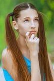 Smiling teenage girl thoughtfully Royalty Free Stock Photo