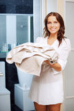 Smiling teenage girl with towels Stock Image