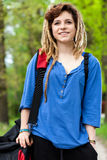 Smiling teenage girl with travel bag Stock Image