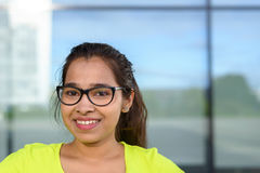 Smiling teenage girl wearing glasses Royalty Free Stock Photos