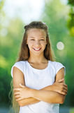 Smiling teenage girl in white Royalty Free Stock Images