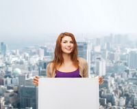 Smiling teenage girl with white board Stock Images