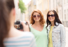 Smiling teenage girls with camera Stock Photos