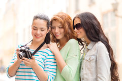 Smiling teenage girls with camera Stock Photo