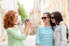 Smiling teenage girls with camera Royalty Free Stock Image