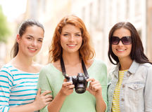 Smiling teenage girls with camera Stock Images