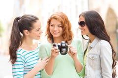 Smiling teenage girls with camera Stock Image