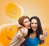 Smiling teenage girls in casual clothes Stock Photo