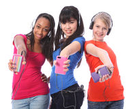 Smiling teenage girls fun with mobile phone music stock photography