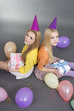 Smiling teenage girls with gifts and colorful balloons Royalty Free Stock Photography
