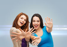 Smiling teenage girls having fun Royalty Free Stock Images