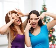 Smiling teenage girls having fun Stock Images