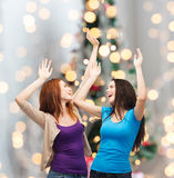 Smiling teenage girls having fun Stock Photos
