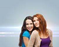 Smiling teenage girls hugging Royalty Free Stock Photography