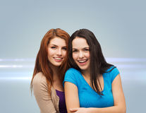 Smiling teenage girls hugging Stock Photography