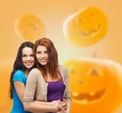 Smiling teenage girls hugging Royalty Free Stock Image