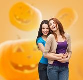 Smiling teenage girls hugging Royalty Free Stock Images