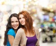 Smiling teenage girls hugging Royalty Free Stock Photo