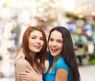 Smiling teenage girls hugging Stock Photography
