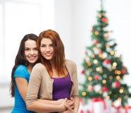 Smiling teenage girls hugging Royalty Free Stock Images