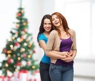 Smiling teenage girls hugging Stock Images