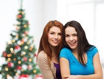 Smiling teenage girls hugging Royalty Free Stock Image
