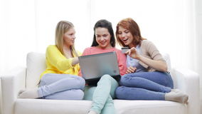 Smiling teenage girls with laptop and credit card Stock Images