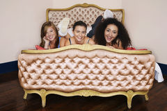 Smiling Teenage Girls Lying On Bed Royalty Free Stock Photos