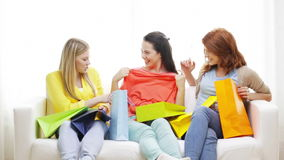 Smiling teenage girls with many shopping bags Stock Photos
