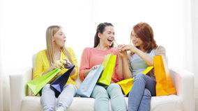 Smiling teenage girls with many shopping bags Royalty Free Stock Image