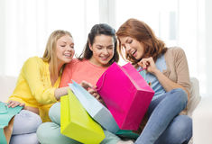 Smiling teenage girls with many shopping bags Stock Photo