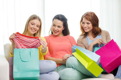 Smiling teenage girls with many shopping bags Stock Images
